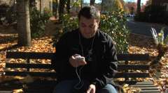 Young man listening to mp3 player - stock footage