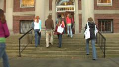 Group of college students walk into building Stock Footage