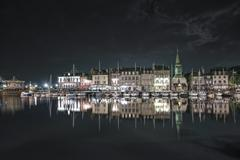 Honfleur night. skyline port and water reflection. normandy, france Stock Photos