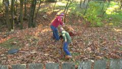 Father and children playing in leaves together Stock Footage