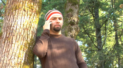 Man talking on cell phone outdoors - stock footage