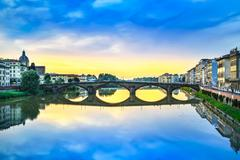 carraia medieval bridge on arno river, sunset landscape. florenc - stock photo