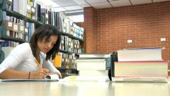 College student studying at a library - stock footage