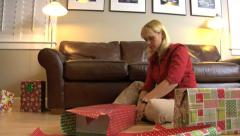 Woman wrapping Christmas presents - stock footage