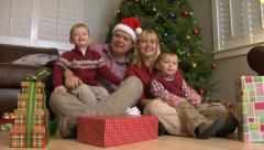 Family portrait by Christmas tree Stock Footage