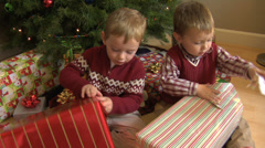 Two young boys opening Christmas gifts Stock Footage