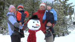 Family with snowman Stock Footage