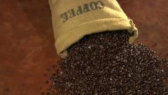 Coffee beans spilling from burlap sack - stock footage
