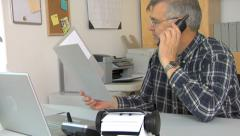 Mature man working in home office - stock footage