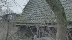 Moving Through Leafless Branches Bushes to Old Abandoned Shed - 29,97FPS NTSC Stock Footage