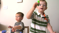 Two boys playing with dough Stock Footage