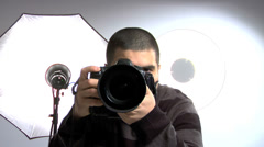 Photographer shooting in the studio Stock Footage