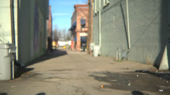 Group of teens walking down an alley - stock footage
