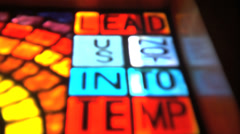 Stained glass window with scripture Stock Footage