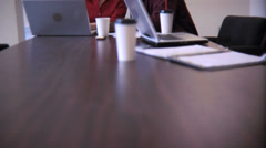 Three business people at desk working together - stock footage