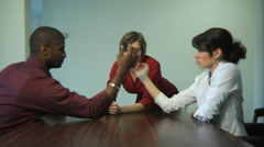 Businesspeople arm wrestling Stock Footage