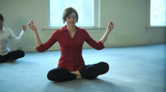 Business people doing yoga in office - stock footage