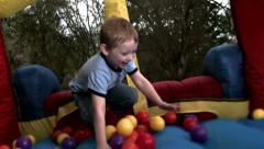 Boy bouncing slow motion Stock Footage