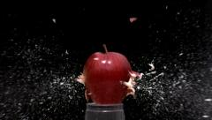 Slow motion bullet through an apple Stock Footage