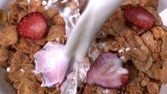 Pouring milk into cereal, slow motion Stock Footage
