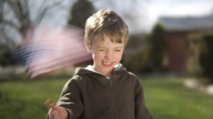 Young boy waving American flag - stock footage