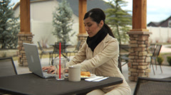 Woman at cafe talking on cell phone - stock footage