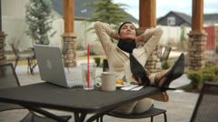 Businesswoman taking a break - stock footage