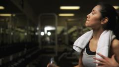 Stock Video Footage of Woman at gym talking on cell phone