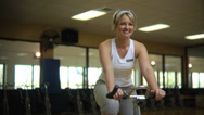 Stock Video Footage of Woman on stationary bicycle