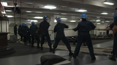 Hauling ropes on the USS Harry S. Truman Stock Footage