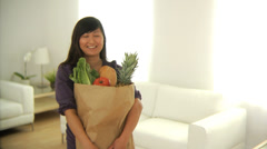 Woman with bag of groceries - stock footage