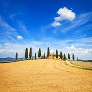 Tuscany, farmland, cypress trees and white road. siena, val d orcia, italy. Stock Photos