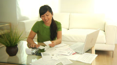 Woman working on personal finances - stock footage