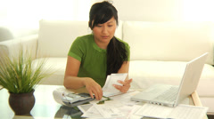 Woman working on finances - stock footage