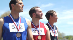 Track athletes with medals Stock Footage