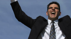 Businessman celebrating with trophy Stock Footage