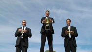 Stock Video Footage of Three businessmen with trophys