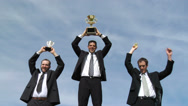 Stock Video Footage of Businessmen celebrating with trophies