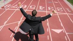 Businessman winning race - stock footage