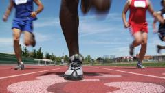 Low angle shot of track runners Stock Footage