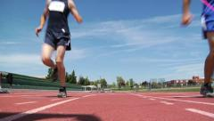 Track runners crossing finish line - stock footage