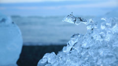 Water drop in blue icebergs and beach Stock Footage