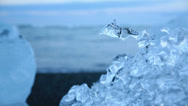 Stock Video Footage of Water drop in blue icebergs and beach