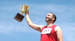 Athlete with trophy celebrating - stock footage