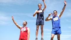 Track athletes on podium celebrating - stock footage
