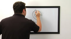 Man draws a dollar sign on  white board Stock Footage