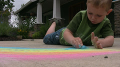 Young boy drawing with chalk Stock Footage