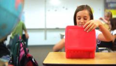 Child eats lunch at school Stock Footage
