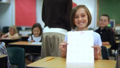 Student holds up paper with an A+ Stock Footage