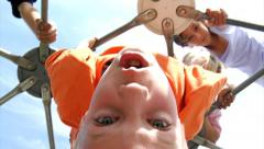 Children climb on play equipment Stock Footage